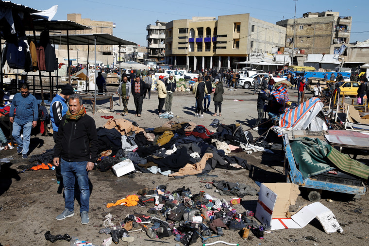 Image: The site of a twin suicide bombing attack in a central market in Baghdad, Iraq