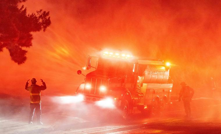 Image: TOPSHOT-US-FIRES