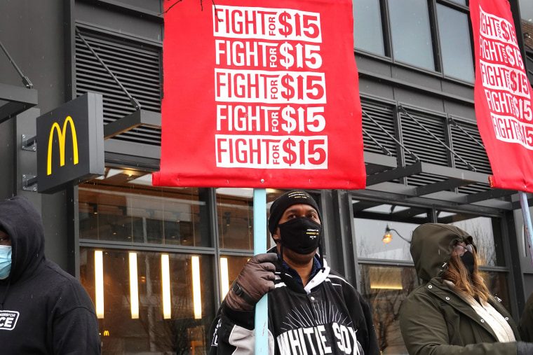 Image: Demonstrators participate in a  protest outside of McDonald's corporate headquarters
