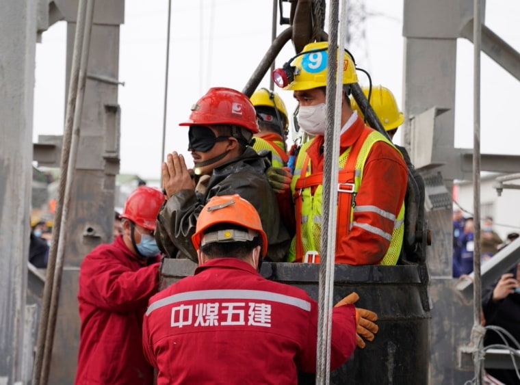 Image: Rescue workers help a miner at the Hushan gold mine after explosion in Qixia, Shandong