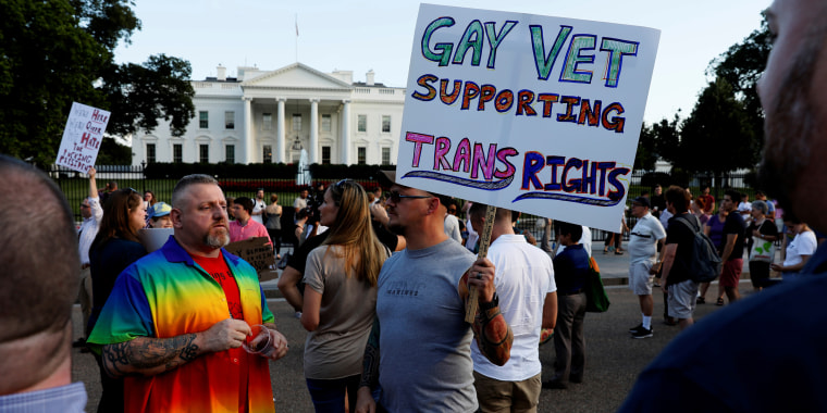 Demonstrators gather to protest Trump's announcement that he plans to reinstate a ban on transgender individuals from serving in the military, at the White House in Washington