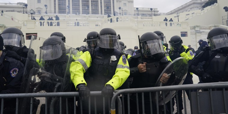Police try to hold back protesters who gathered to storm the Capitol, on Jan. 6, 2021.