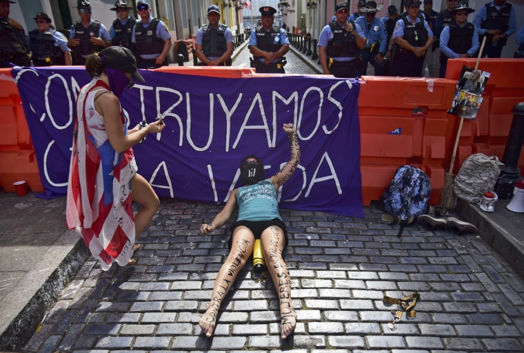 The activist group, Feminist Collective in Construction, protests near La Fortaleza governor's residence as they demand the declaration of a state of emergency in response to gender-based violence against women in San Juan, Puerto Rico, on Aug. 22, 2019.