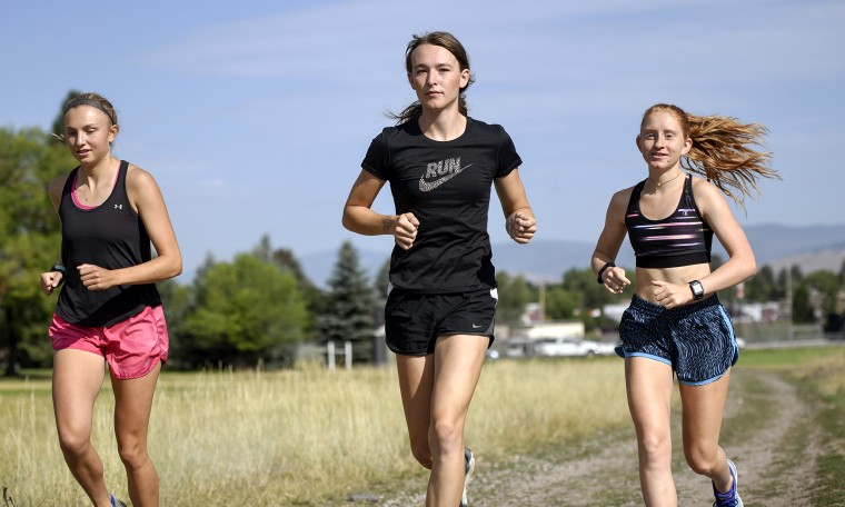 University of Montana cross country runner Juniper Eastwood, center, warming up with her teammates at Campbell Park in Missoula, Mont. on Aug. 15, 2019.