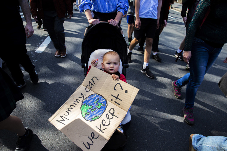 Image: Thousands of school students and protesters march along College Street during a climate strike rally in Sydney