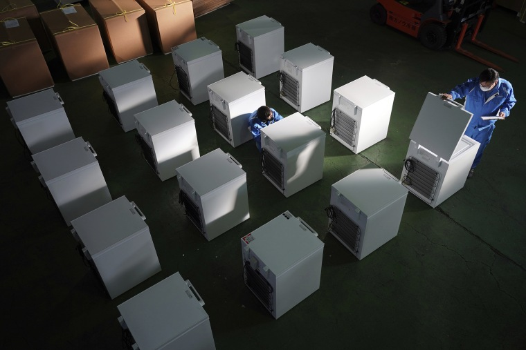 Image: Brand-new ultralow-temperature freezers are seen at a warehouse at Kanou Reiki, a freezer supplier