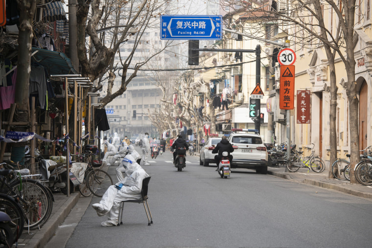Image: Health workers in protective suits are seen in the Huangpu district on Jan. 28, 2021 in Shanghai, China.