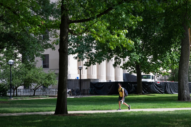 A student walks through the Diag on the University of Michigan campus in Ann Arbor