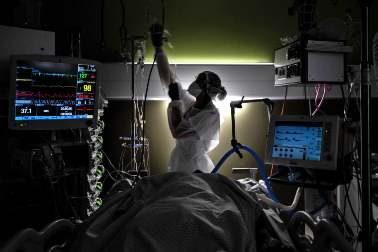 A nurse takes care of a Covid-19 patient in the intensive care unit of Lyon-Sud hospital in Pierre-Benite, France, on Jan. 25, 2021.