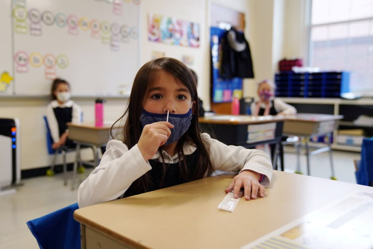Image: Children swab and test themselves for COVID-19 in the classroom in Boston