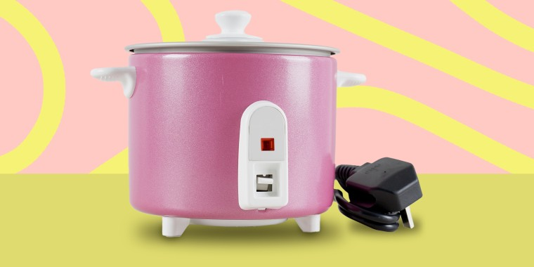 Pink rice cooker on yellow background