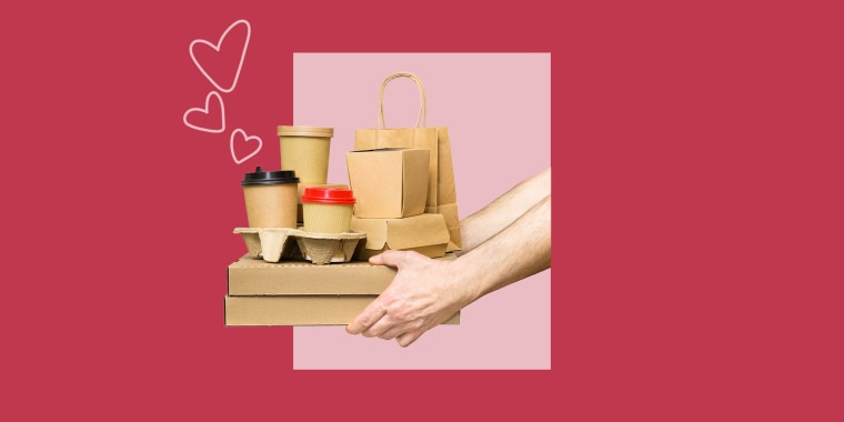 Hands holding various take-out food containers, pizza box, coffee cups in holder and paper bag isolated on white. Food delivery service