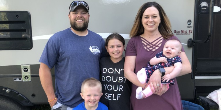 Sarah Nelson holds her baby Adalynn, born in February 2020. The family also includes, from left to right, her husband Branden, and kids Emmitt and Brooklyn.
