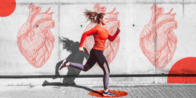 Woman running with heart graffiti on the wall behind her