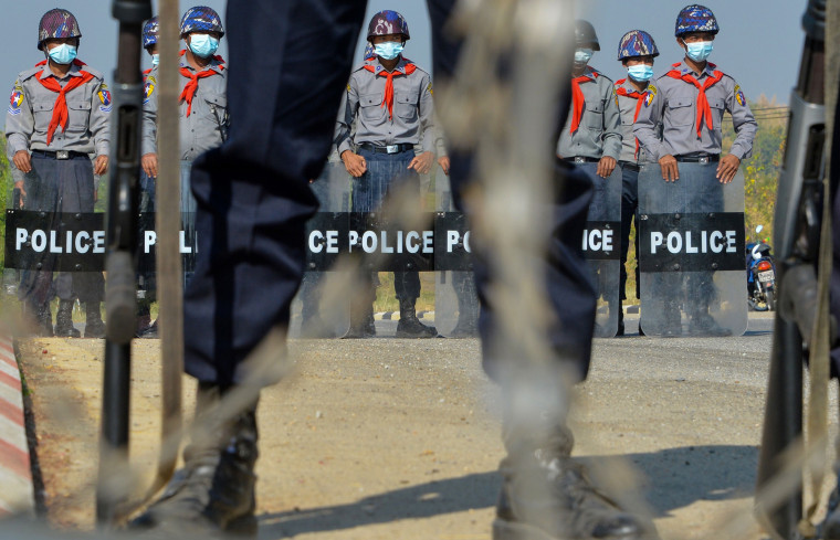 Image: Police wearing stand guard in Naypyidaw, Myanmar.