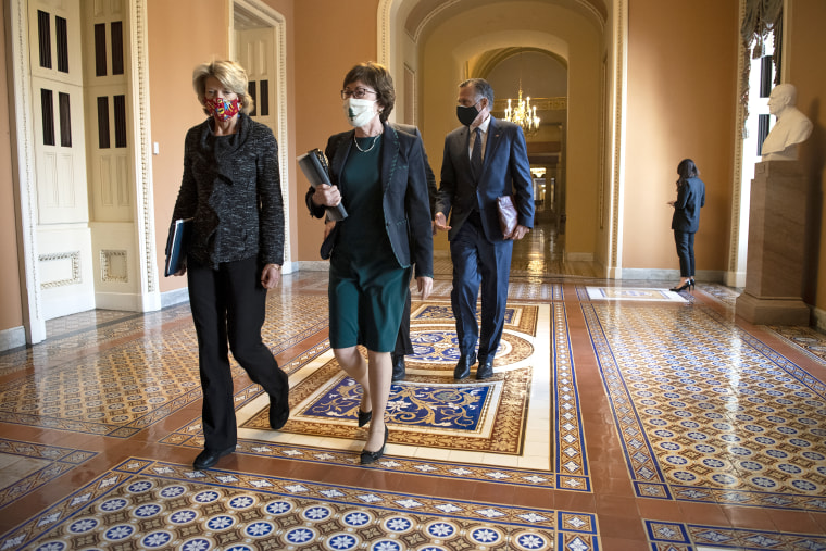 Sen. Lisa Murkowski, R-Alaska, left, Sen. Susan Collins, R-Maine, Sen. Bill Cassidy, R-La., and Sen. Mitt Romney, R-Utah, depart from a meeting with Senate Majority Leader Mitch McConnell, R-Ky., in his office in Washington on Dec. 3, 2020.