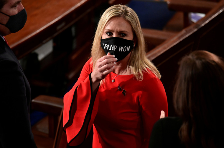 "Image: Rep. Marjorie Taylor Greene (R-GA) wears a ""Trump Won"" face mask as she arrives to take her oath of office as a member of the 117th Congress in Washington"