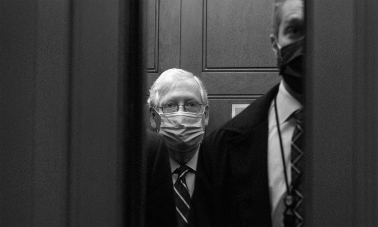 Image: Mitch McConnell boards an elevator after leaving the Senate floor.