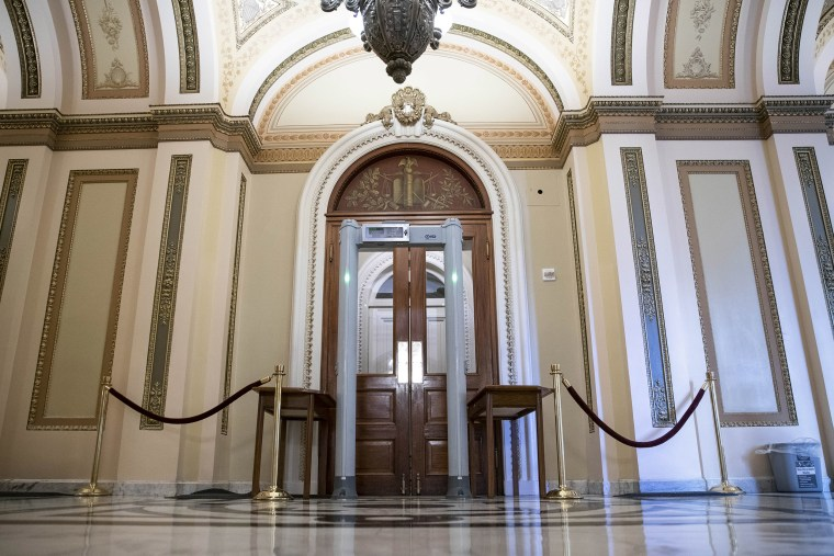 Image: A metal detector stands outside of the House chamber at the U.S. Capitol.