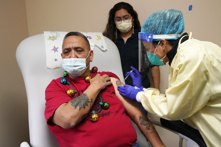 Lummi Nation member James Scott, whose native name is Qwelexwbed, get the first Covid-19 vaccination on the Lummi Reservation near Bellingham, Wash., on Dec. 17.
