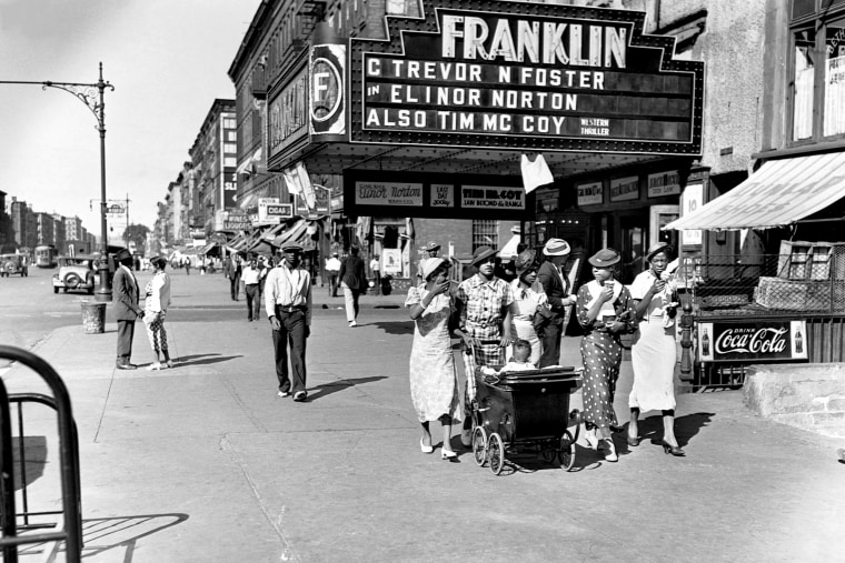 Image: Pedestrians on a summer day in Harlem, N.Y., in 1935.