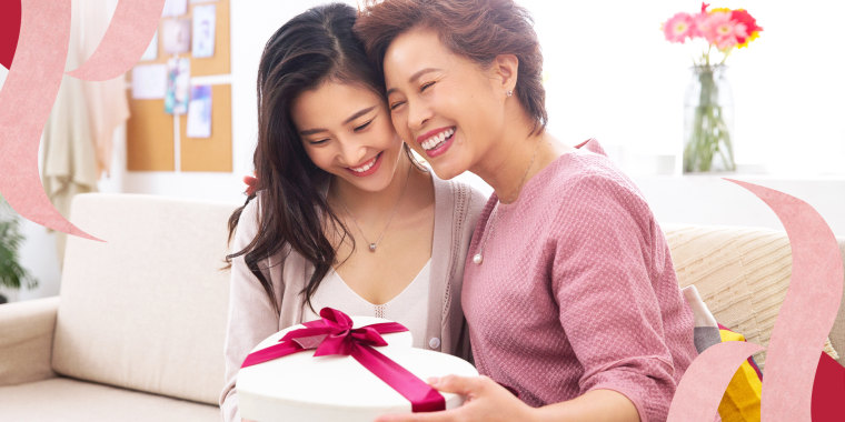Mom and daughter hugging with a gift