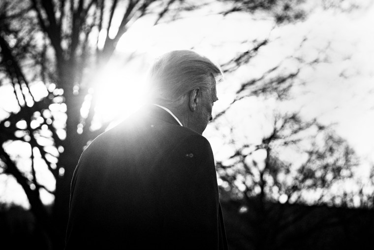 President Donald Trump walks on the South Lawn of the White House before boarding Marine One on Jan. 20, 2021.