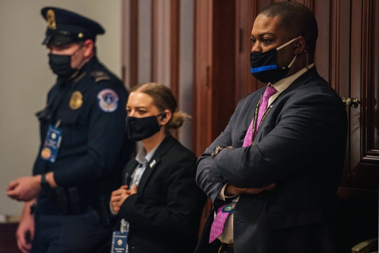 Image: Capitol Police Officer Eugene Goodman and officers watche newly released video footage, of the January 6 attack, during the second day of Trumps second impeachment trial on Feb. 10, 2021.