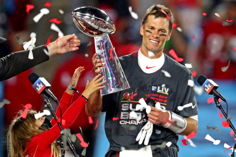 Image: Tampa Bay Buccaneers quarterback Tom Brady (12) celebrates with the Vince Lombardi Trophy after beating the Kansas City Chiefs in Super Bowl LV at Raymond James Stadium on Feb. 7, 2021.