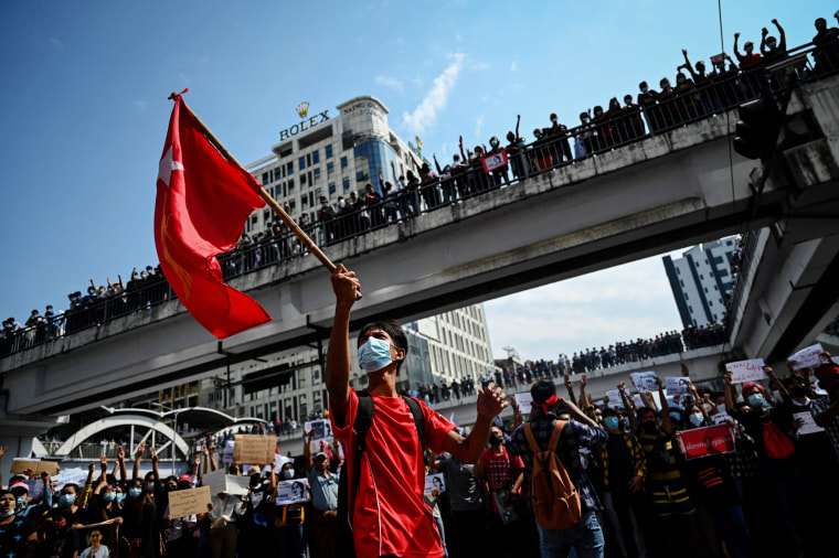 Image: Protesters gather to demonstrate against the February 1 military coup, in downtown in Yangon on Feb. 8, 2021.