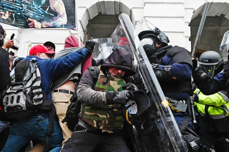 Police push rioters after they stormed the Capitol on Jan. 6, 2021.