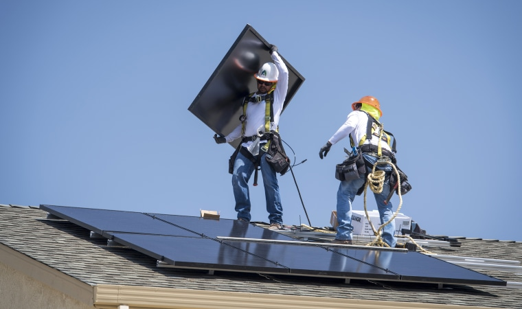 Image: SunRun Solar Panel Installations As California Becomes First State To Order On New Homes