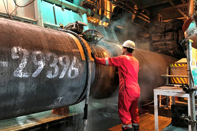 Image: FILE PHOTO: A specialist works onboard the Allseas' deep sea pipe laying ship Solitaire to prepare a pipe for Nord Stream 2 pipeline in the Baltic Sea