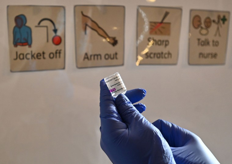 A health worker prepares a dose of the AstraZeneca/Oxford Covid-19 vaccine in Hull, England, on Feb. 10, 2021.