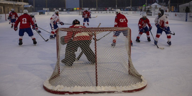 Players take part in the World's Longest Hockey Game near Edmonton in Canada on Feb. 11.