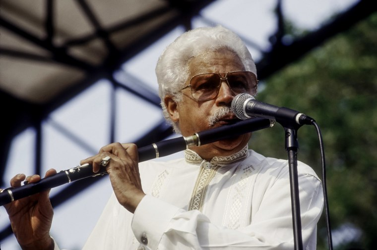 Image: Dominican musician and bandleader Johnny Pacheco plays flute onstage at Central Park SummerStage, New York.
