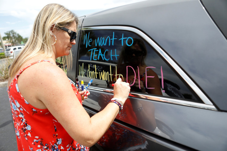 Florida teachers hold a protest in front of the Pasco County School district office