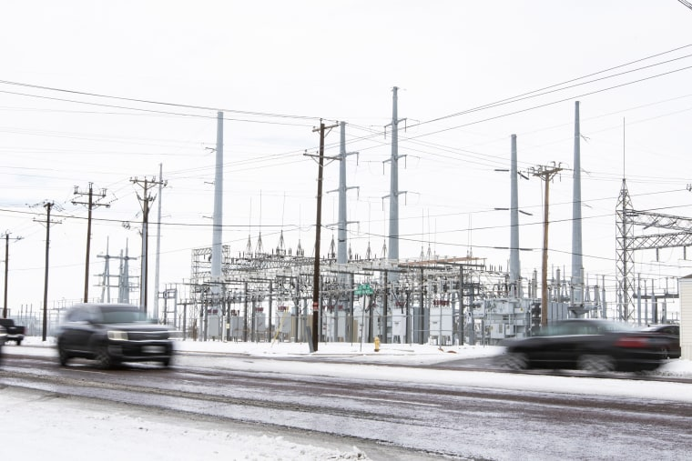 Image: Motorist on County Road West drive past a power station Tuesday, Feb. 16, 2021, in Odessa, Tx.