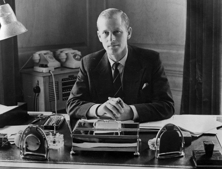Prince Philip, the Duke of Edinburgh, sitting at his desk at Clarence House on Aug. 10, 1951.