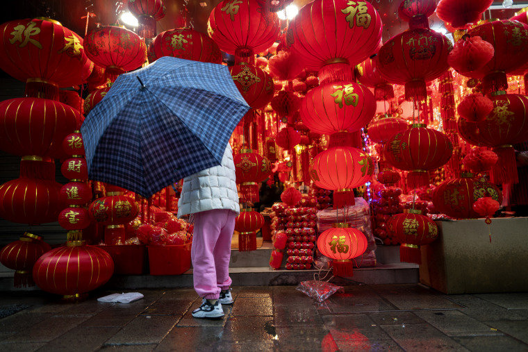 Image; A woman shops for lanterns ahead of Chinese New Year in Shaoxing, China, on Feb. 11, 2021.
