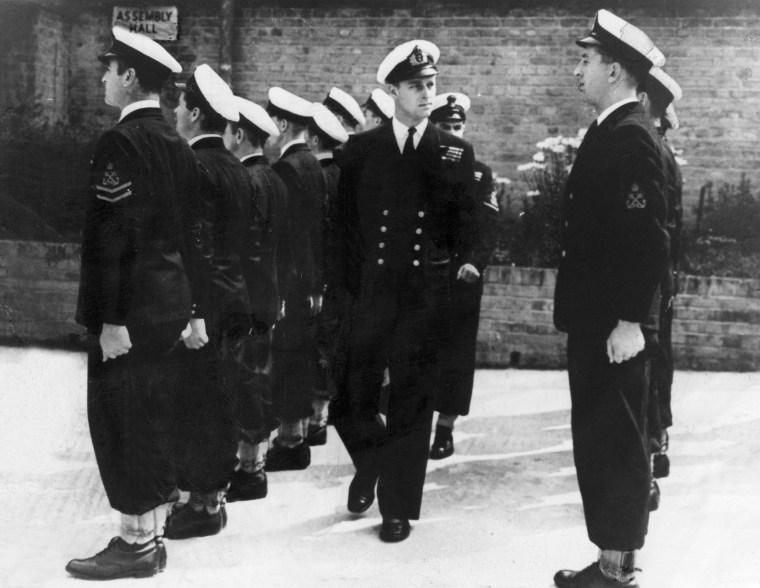 Prince Philip as a naval officer inspecting soldiers of the naval school in Corsham, England in 1946 .