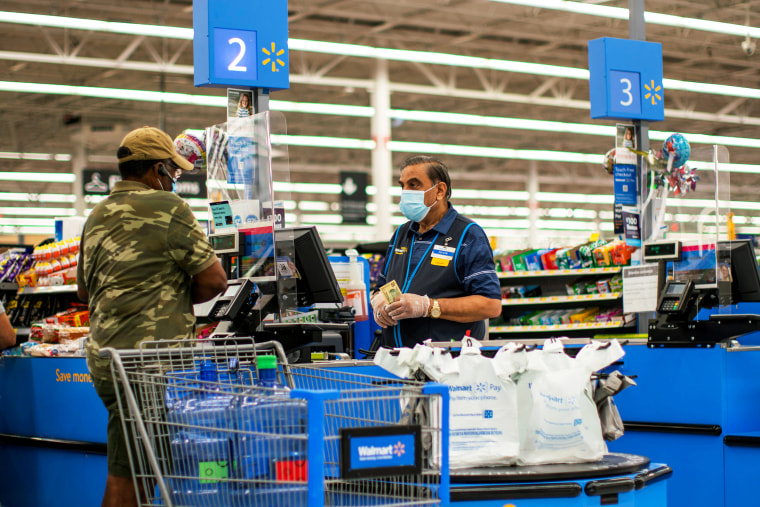 Image: FILE PHOTO: FILE PHOTO: A worker and a shopper are seen wearing masks at a Walmart store, in North Brunswick, New Jersey