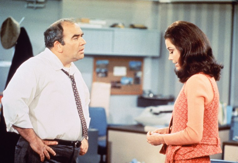 """Edward Asner as Lou Grant and Mary Tyler Moore as Mary Richards in a scene from """"The Mary Tyler Moore Show"""" in 1970."""