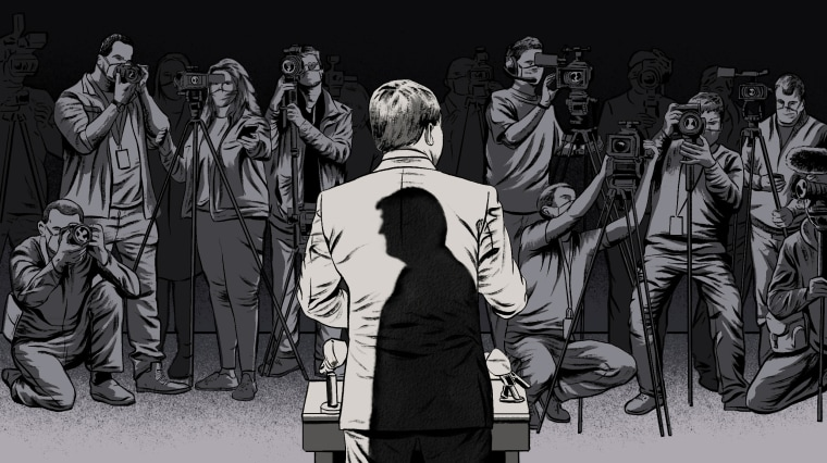 Image: Illustration shows a man in a suit, with Donald Trump's shadow on his back, speaking to a press corps with cameras and microphones.