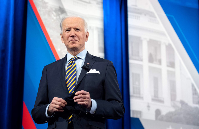 Image: President Joe Biden holds a face mask as he participates in a CNN town hall at the Pabst Theater in Milwaukee on Feb. 16, 2021.