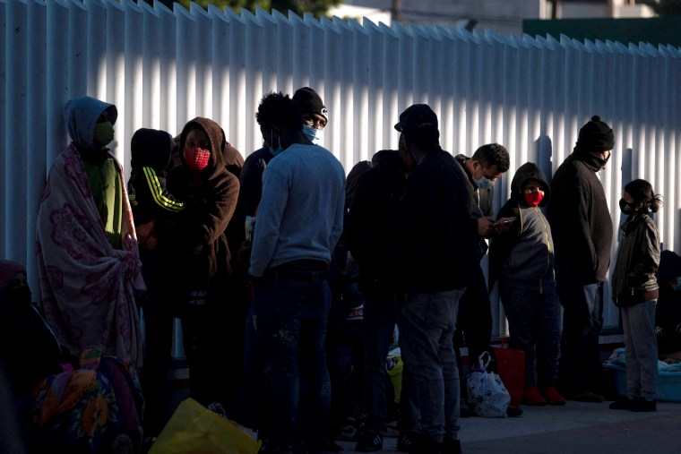 Image: Asylum seekers wait outside El Chaparral crossing port as they try to cross to the United States in Tijuana, Baja California state, Mexico on Feb. 19, 2021.