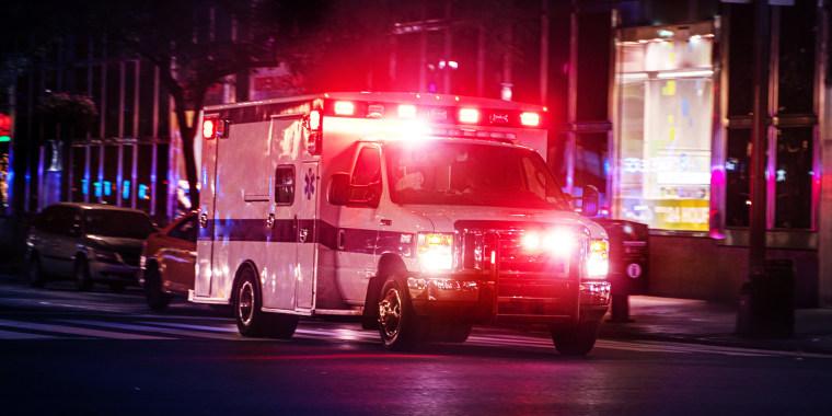 Ambulance speeding at night in New York City