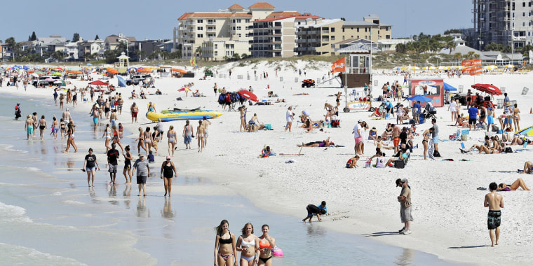 Visitors at Clearwater Beach, Fla., on March 18.