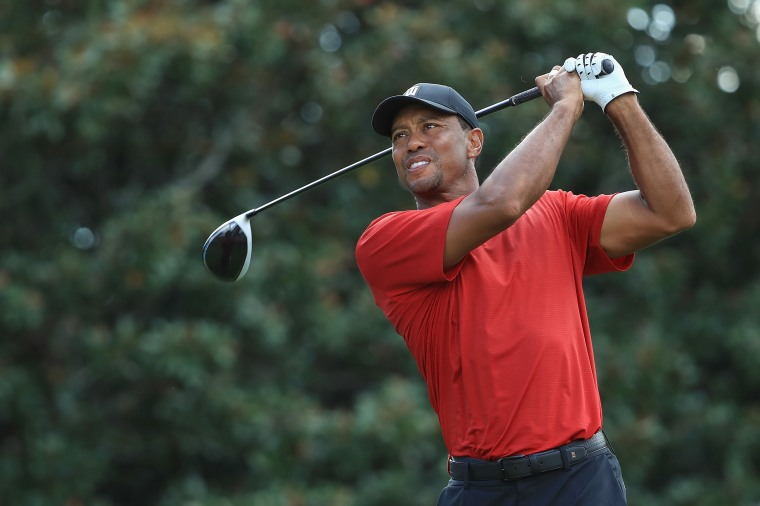 Image:  Tiger Woods of the United States plays his shot from the 14th tee during the final round of the TOUR Championship