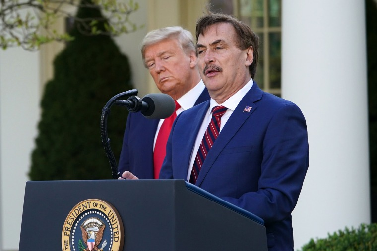 Image: President Donald Trump listens as Michael J. Lindell, CEO of MyPillow Inc., speaks during the daily briefing on the novel coronavirus, Covid-19, in the Rose Garden of the White House on March 30, 2020.